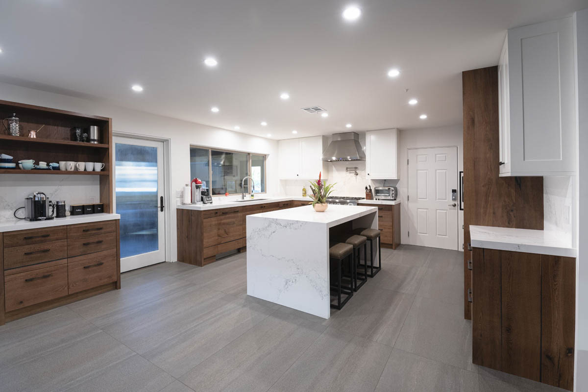 Fitucci Custom Cabinets - Los Angeles - kitchen where everything is built with white marble and custom cabinets. photo is taken from inside corner