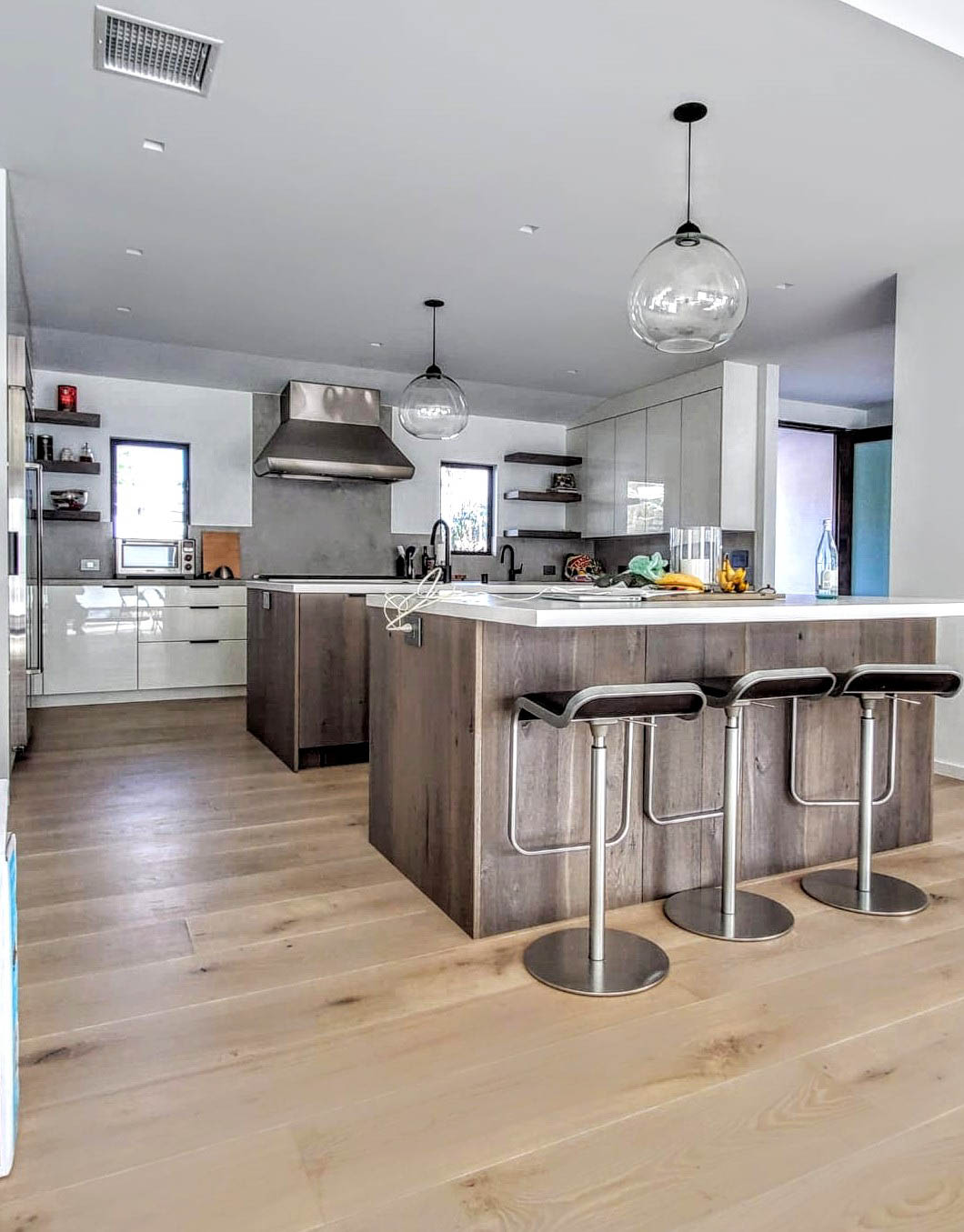 Fitucci Custom Cabinets - Los Angeles - modern looking kitchen island with custom built lower part. the chairs have no arms rests