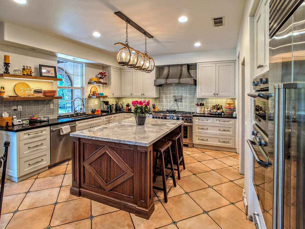 Fitucci Custom Cabinets - Los Angeles - diagonal photo of kitchen with custom cabinets and island in the middle