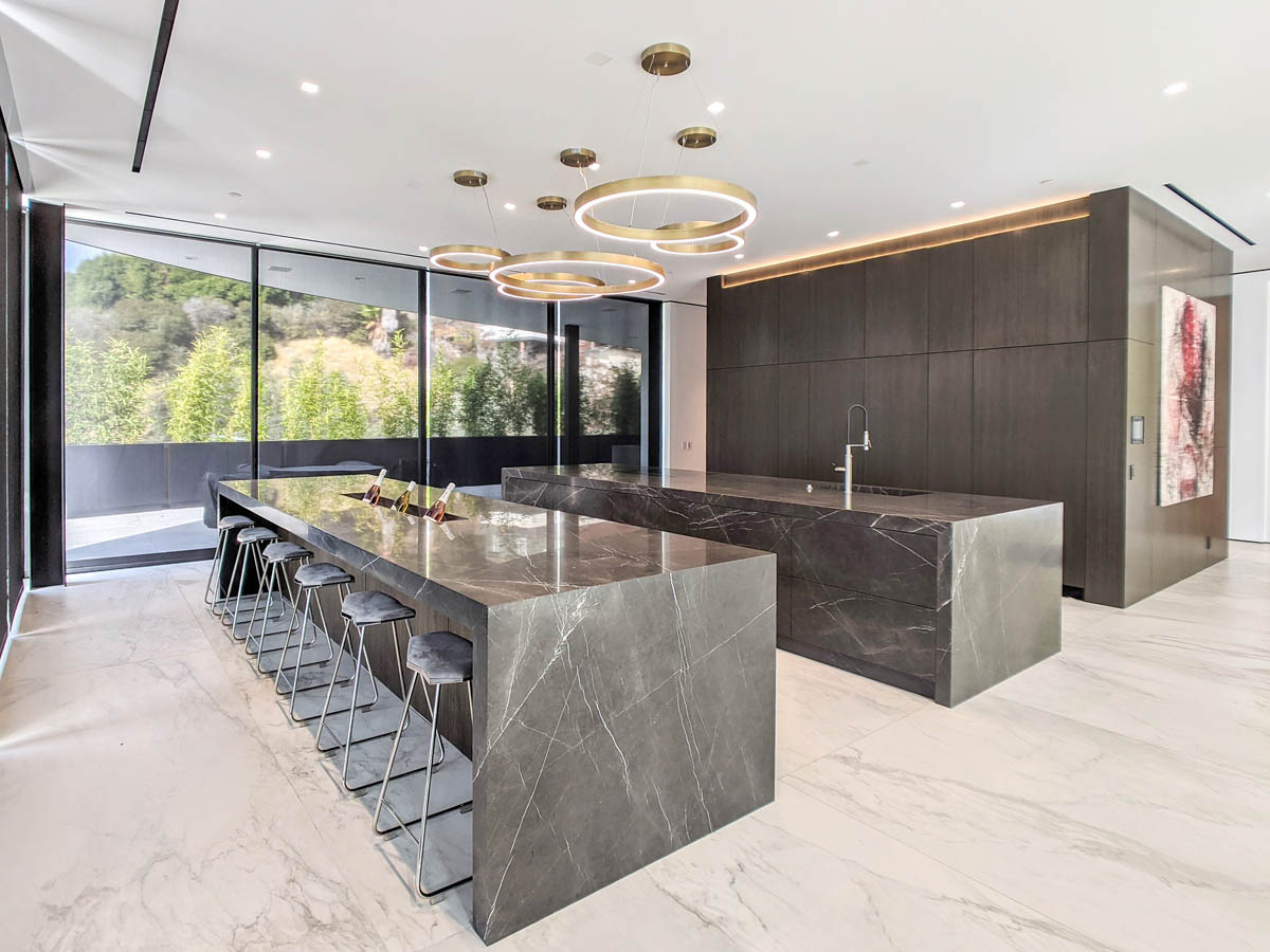 Fitucci Custom Cabinets - Los Angeles - islands built with marble and they have custom cabinets on the opposite end of the chairs